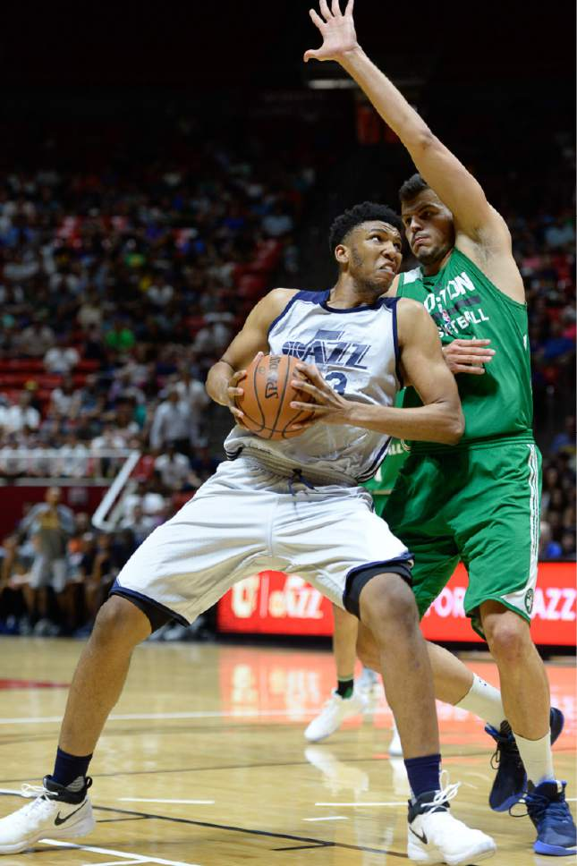 Francisco Kjolseth | The Salt Lake Tribune Tony Bradley of the Utah Jazz tries to push past Ante Zizic of the Boston Celtics during the first half of an NBA Summer league basketball game at the Huntsman Center, July 6, 2017, in Salt Lake City.