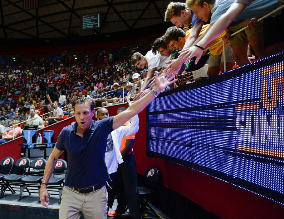 Francisco Kjolseth | The Salt Lake Tribune Utah Jazz coach Quin Snyder gets high fives from the fans as the Jazz get ready to take on the Celtics during the NBA Summer league basketball game at the Huntsman Center, July 6, 2017, in Salt Lake City.