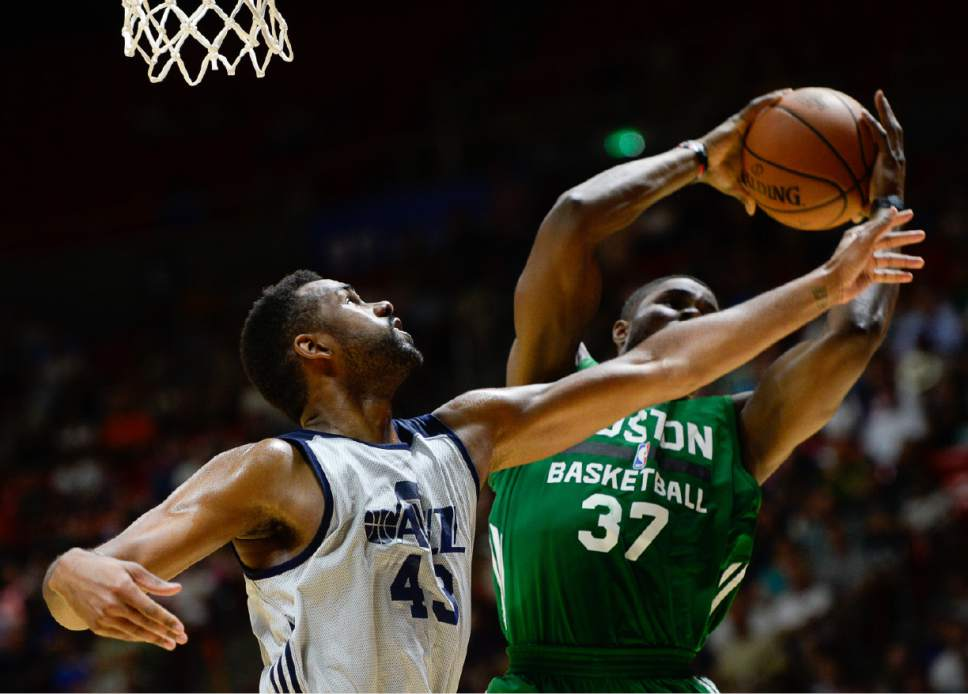 Francisco Kjolseth | The Salt Lake Tribune James Sutherland of the Utah Jazz battles Semi Ojeleye of the Boston Celtics during the NBA Summer league basketball game at the Huntsman Center, July 6, 2017, in Salt Lake City.