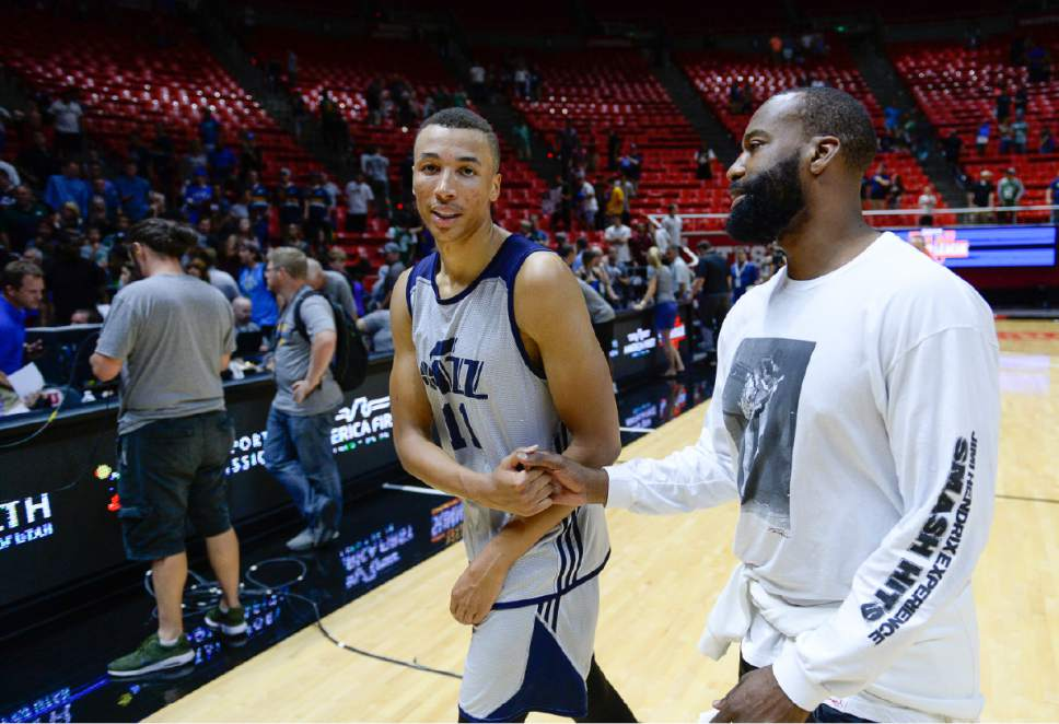Francisco Kjolseth | The Salt Lake Tribune Danté Exum gets a few pointers from former Utah Jazz player Baron Davis following Exum's NBA Summer league game against the Boston Celtics  at the Huntsman Center, July 6, 2017, in Salt Lake City.