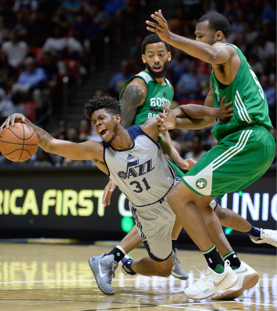 Francisco Kjolseth | The Salt Lake Tribune Tyrone Wallace of the Utah Jazz gets squeezed by Terran Petteway and Trevor Thompson of the Boston Celtics during the first half of an NBA Summer league basketball game at the Huntsman Center, July 6, 2017, in Salt Lake City.