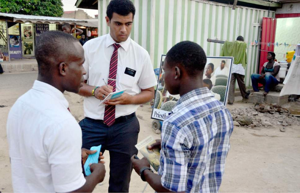 Mike Stack  |  Special to The Salt Lake Tribune Elder Isaac Nyarko, left, and Elder Aumua attempt to make an appointment to teach during a typical LDS missionary street display in Accra, Ghana, in 2014. Mormon growth is surging in parts of Africa.