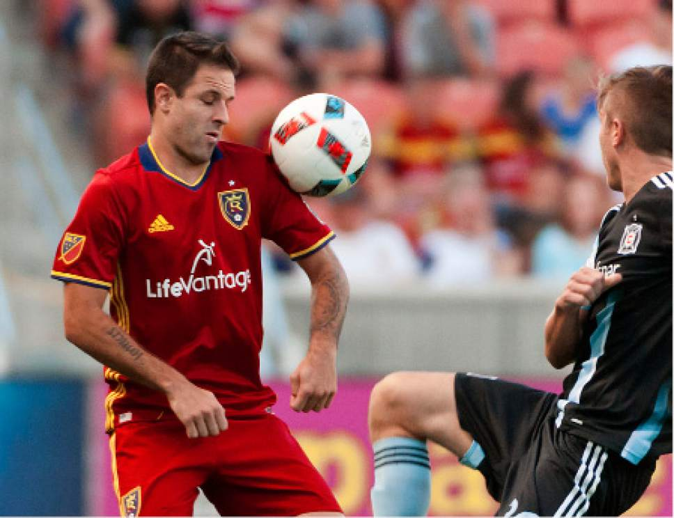 Michael Mangum  |  Special to the Tribune  Real Salt Lake forward Juan Manuel Martinez (7) hits the ball with his shoulder in front of Chicago Fire midfielder Michael Stephens (26) during their MLS match at Rio Tinto Stadium in Sandy, Utah on Saturday, August 6th, 2016.