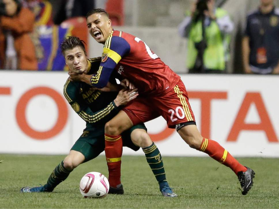Portland Timbers' Jorge Villafana, left, and Real Salt Lake' Luis Silva (20) battle for the ball during the second half of an MLS soccer match Wednesday, Oct. 14, 2015, in Sandy, Utah. The Timbers won 1-0. (AP Photo/Rick Bowmer)