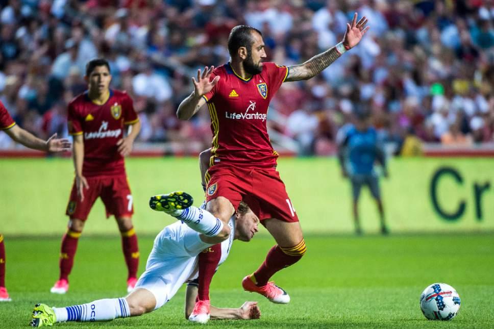 Chris Detrick  |  The Salt Lake Tribune Real Salt Lake forward Yura Movsisyan (14) and Orlando City SC defender Jonathan Spector (2) go for the ball during the game at Rio Tinto Stadium Friday, June 30, 2017.