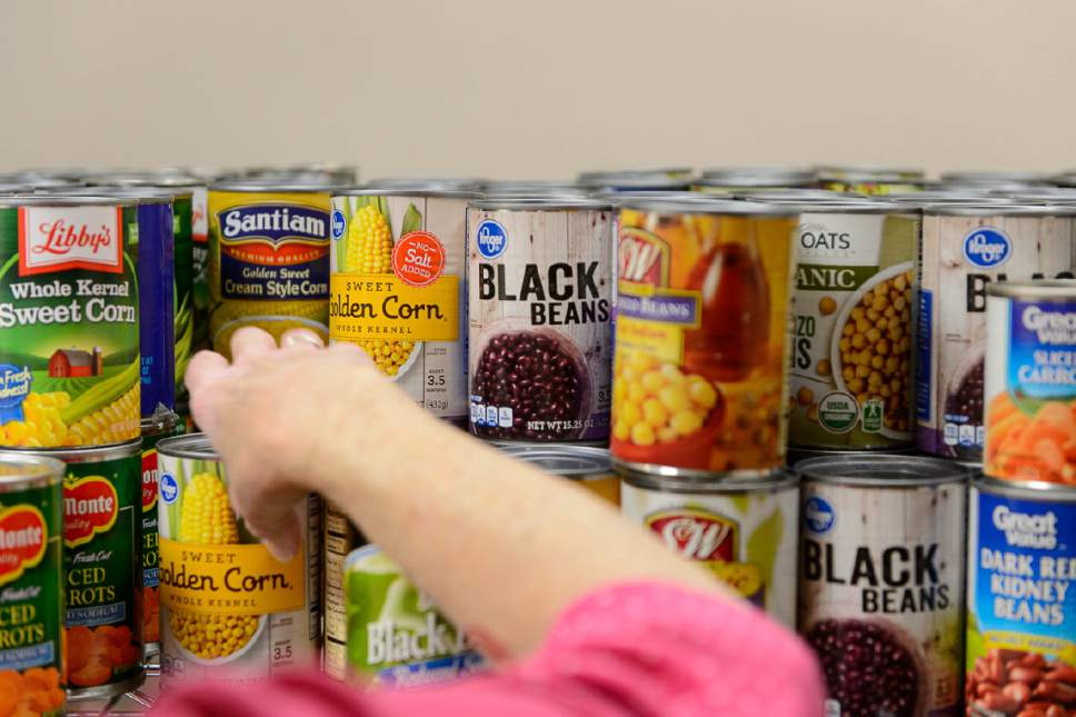 Trent Nelson  |  The Salt Lake Tribune   Shannon Callahan selects food at the Salt Lake VA's new food pantry, Thursday June 22, 2017. Research shows one-quarter of vets who get care through VA reported food insecurity in the past month. That's a higher rate than the general population.