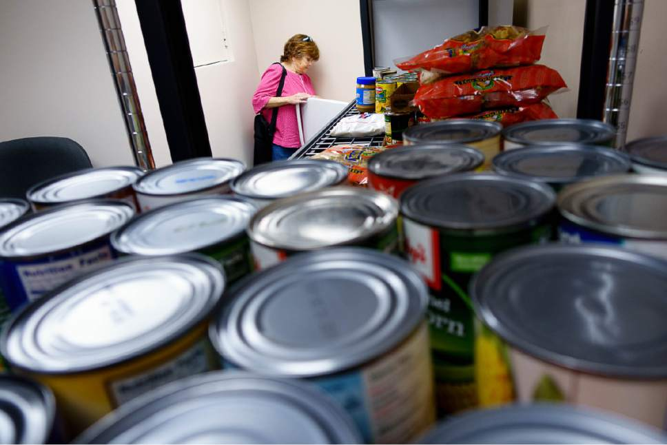 Trent Nelson  |  The Salt Lake Tribune   Shannon Callahan selects food at the Salt Lake VA's new food pantry, Thursday June 22, 2017. Research shows one-quarter of vets who got care through VA reported food insecurity in the past month. That's a higher rate than the general population.