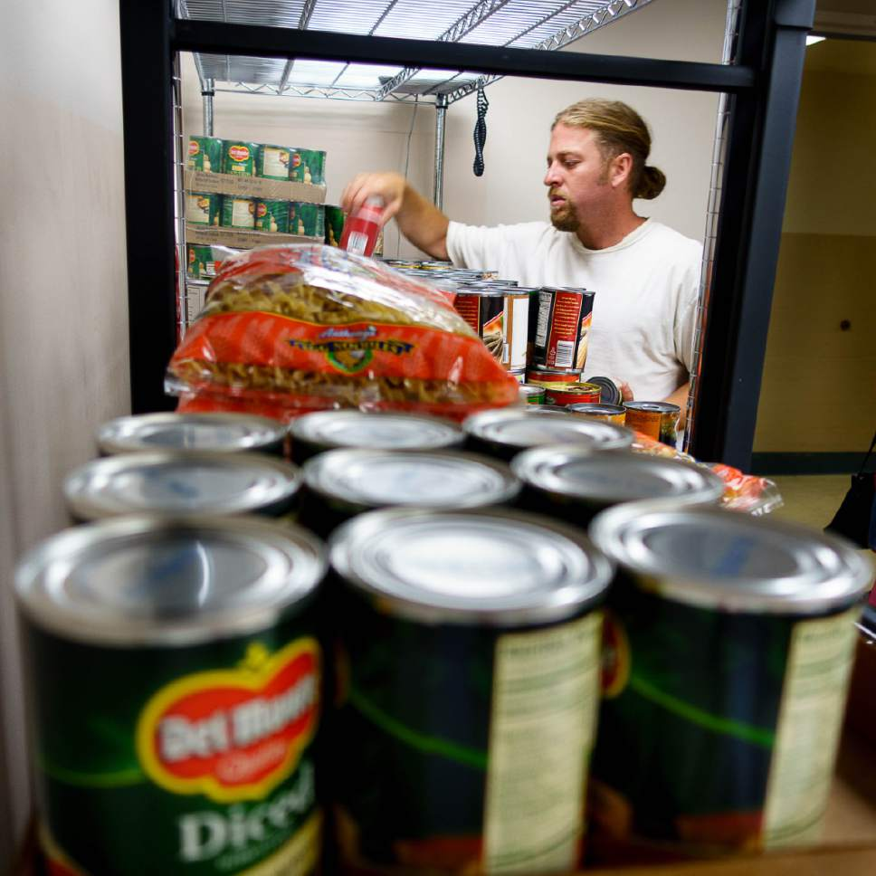 Trent Nelson  |  The Salt Lake Tribune   Aaron Hornok selects food at the Salt Lake VA's new food pantry, Thursday June 22, 2017. Research shows one-quarter of vets who got care through the VA reported food insecurity in the past month. That's a higher rate than the general population.
