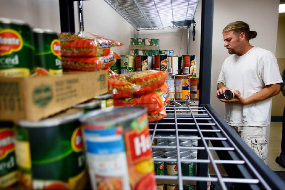 Trent Nelson  |  The Salt Lake Tribune   Aaron Hornok selects food at the Salt Lake VA's new food pantry, Thursday June 22, 2017. Research shows one-quarter of vets who got care through VA reported food insecurity in the past month. That's a higher rate than the general population.