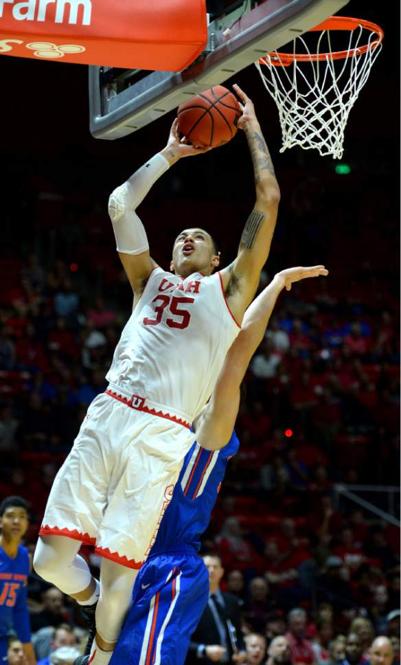 Steve Griffin  |  The Salt Lake Tribune   Utah Utes forward Kyle Kuzma (35) leans in and scores during the Utah versus Boise State basketball game in the first round of the NIT at the Huntsman Center on the University of Utah campus in Salt Lake City Tuesday March 14, 2017.