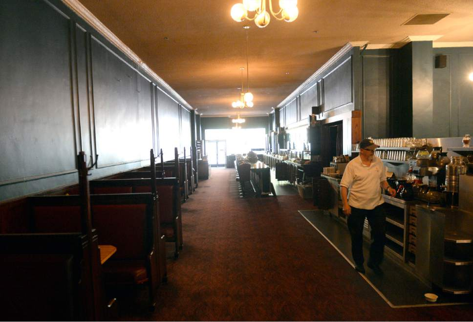 Al Hartmann  |  The Salt LakeTribune  Lamb's Grill, the historic downtown Salt Lake City restaurant that closed in April after years of financial struggle, is being gutted. But pieces of its 100-year-old history will be saved and refurbished for a new restaurant to open next year in Orem. On Friday, July 7, 2017, carpenters started dismantling the red oak tables and booths.