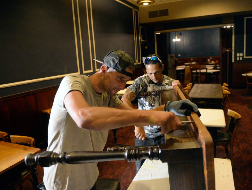 Al Hartmann  |  The Salt LakeTribune Patrick Zitting, left, and Anthony Rodriguez take apart tables in the old Lamb's Grill dining room where power brokers of Utah met for decades.Now that the restaurant is closed for good, the original Art Deco booths, lunch counter and woodwork from 1917 will be  refurbished for a new restaurant that will open next year in Orem. Friday, June 7, 2017