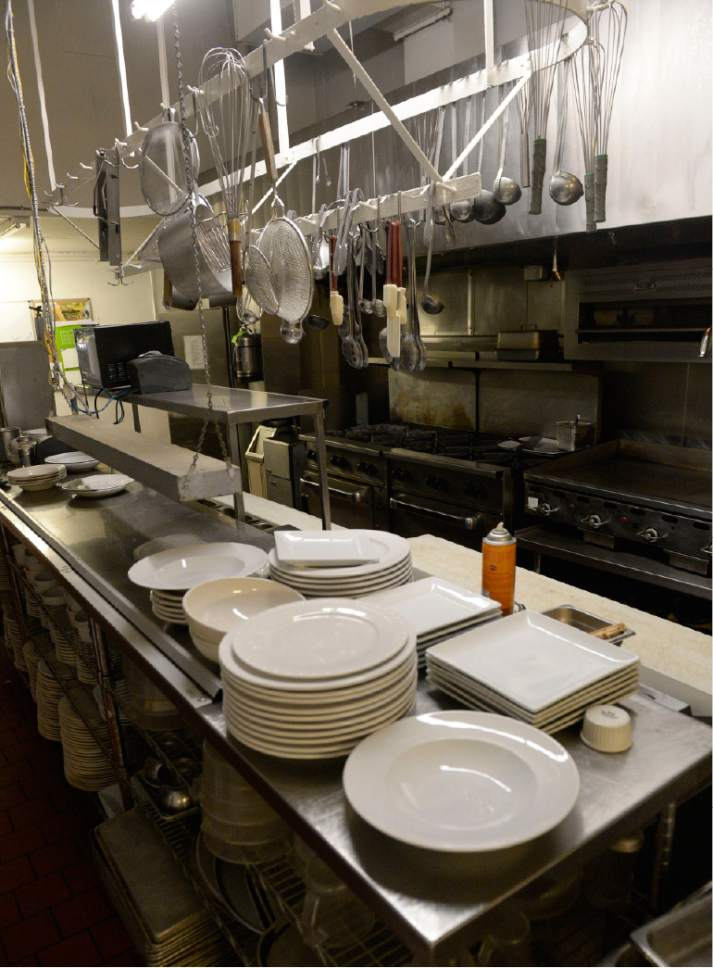 Al Hartmann  |  The Salt LakeTribune Lamb's Grill, the historic downtown Salt Lake City restaurant that closed in April after years of financial struggle, is being gutted. On Friday, July 7, 2017, carpenters started dismantling the red oak tables and booths. Glasses, plates and flatware will be donated to Catholic Community Services.