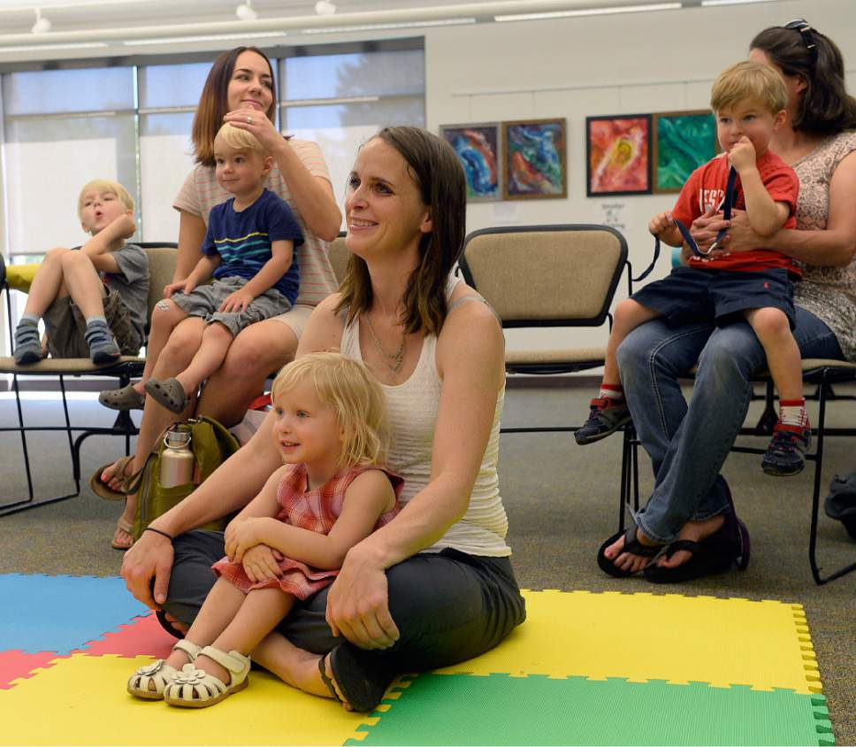 Al Hartmann  |  The Salt Lake Tribune   Heather May and her daughter, Margot, take in preschool storytime at the Holladay Library Thursday, June 22, 2017.