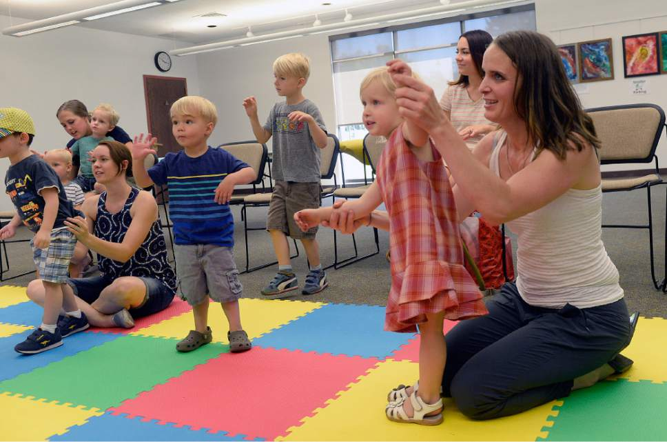 Al Hartmann     The Salt Lake Tribune   Heather May and her almost 3-year-old daughter Margot , right, get the wiggles out with other preschoolers and parents during storytime at the Holladay Library, Thursday, June 22, 2017.
