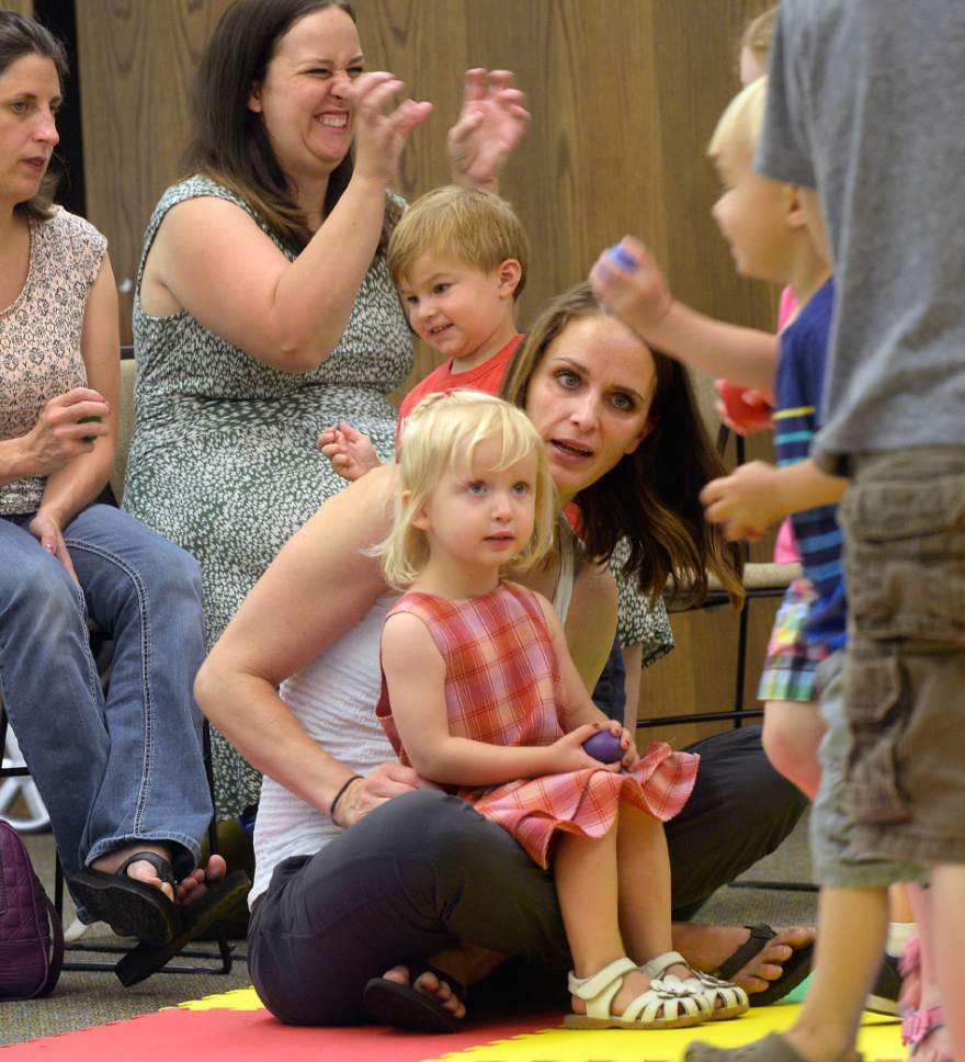 Al Hartmann  |  The Salt Lake Tribune   Heather May and her 2-year-old daughter, Margot, take in preschool storytime at the Holladay Library Thursday, June 22, 2017.