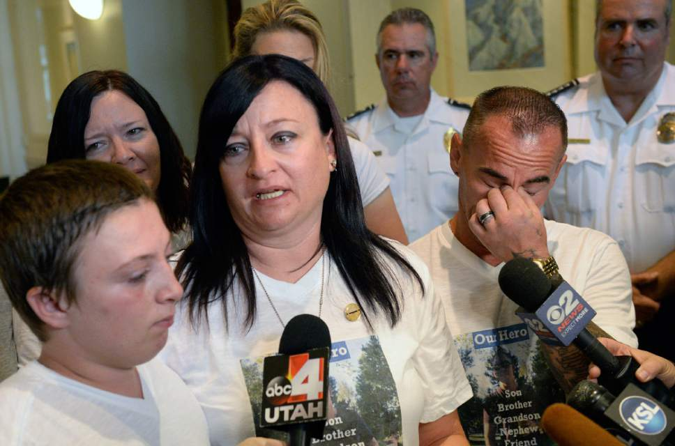 Al Hartmann  |  The Salt LakeTribune Family members of fallen West Valley City police officer Cody Brotherson,  Alex, 9, (brother), left, Jenny, (Mother), and Jeff Brotherson, (Father), talk to the media upon leaving court in Salt Lake City, Monday July 10, 2017.  Three teenage boys who admitted responsibility for the November death of West Valley City police Officer Cody Brotherson were ordered by a juvenille judge to serve time in a secure juvenile care facility for as long as possible.  West Valley Police officer Cody Brotherson, 25, was killed Nov. 6 when he was struck by a stolen vehicle ó in which the three teens were riding ó while laying down a set of spike strips.