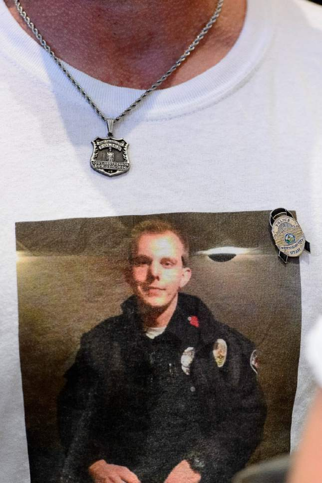 Trent Nelson  |  The Salt Lake Tribune Fallen West Valley City police officer Cody Brotherson appears on his father Jeff's shirt, Wednesday June 28, 2017.
