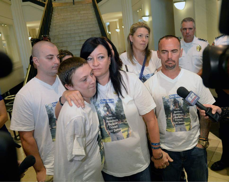 Al Hartmann  |  The Salt LakeTribune Family members of fallen West Valley City police officer Cody Brotherson,  Alex, 9, (brother) left, Jenny, (Mother), and Jeff Brotherson, (Father), talk to the media upon leaving court in Salt Lake City, Monday July 10, 2017.  Three teenage boys who admitted responsibility for the November death of West Valley City police Officer Cody Brotherson were ordered by a juvenille judge to serve time in a secure juvenile care facility for as long as possible.  West Valley Police officer Cody Brotherson, 25, was killed Nov. 6 when he was struck by a stolen vehicle -- in which the three teens were riding -- while laying down a set of spike strips.