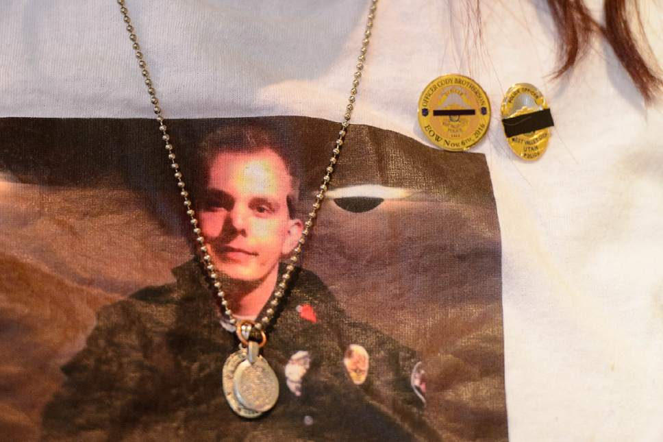 Trent Nelson  |  The Salt Lake Tribune Fallen West Valley City police officer Cody Brotherson appears on his mother Jenny's shirt, Wednesday June 28, 2017.