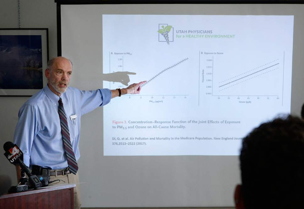 Scott Sommerdorf   |  The Salt Lake Tribune   Dr. Robert Paine, UPHE Board Member and Professor of Internal Medicine and Chief of the Division of Respiratory, Critical Care and Occupational Pulmonary Medicine at the University of Utah School of Medicine, points out aspects of the Ozone and PM2.5 levels and their affects on mortality during a press conference, Wednesday, July 12, 2017.  A study published in The New England Journal of Medicine, one of the largest studies of its kind to date involving 61 million people throughout the United States, strengthens the association between premature death and PM2.5 and ozone. UPHE Board President, Dr. Brian Moench