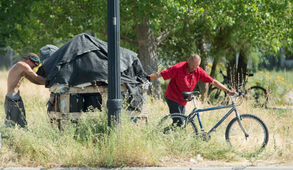 Rick Egan  |  The Salt Lake Tribune  Homeless campers are forced to remove their belongings from the Rio Grande area of Salt Lake City, as the Salt Lake County Health Department brings in heavy machinery to clean up the space on Thursday, July 6, 2017. The biggest challenge for crews is the disposal of syringes discarded by drug users.