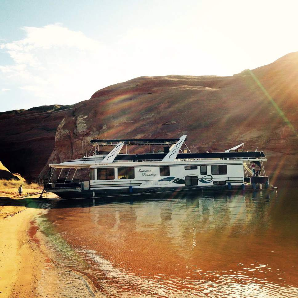 One dead 4 critically injured in lake powell house boat for Powell house