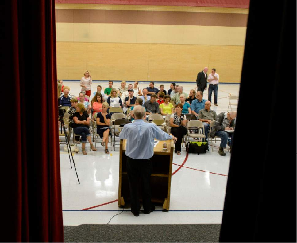 Steve Griffin  |  The Salt Lake Tribune   A small group of people listen to Paul Thompson, a Utah educator and former President of Weber State University, as Our Schools Now holds 7 simultaneous town halls throughout Utah to explain and receive feedback on its ballot initiative to raise $700 million for public education through income and sales tax increases. Orem Elementary School hosted this meeting in Orem Tuesday July 11, 2017.