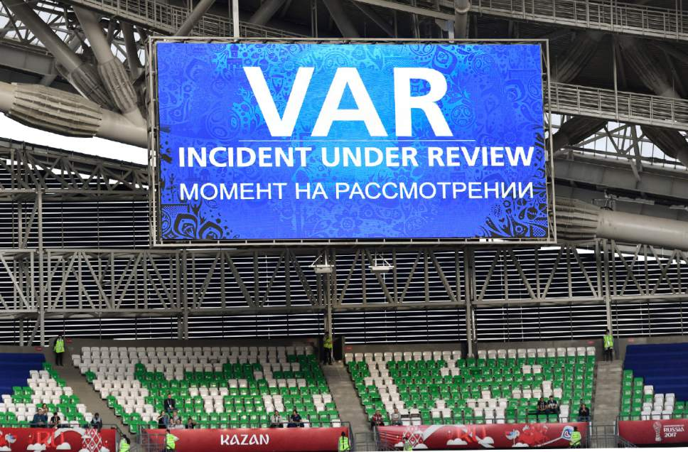 A giant screen reports a VAR incident is being reviewed during the Confederations Cup, Group A soccer match between Portugal and Mexico, at the Kazan Arena, Russia, Sunday, June 18, 2017. (AP Photo/Martin Meissner)