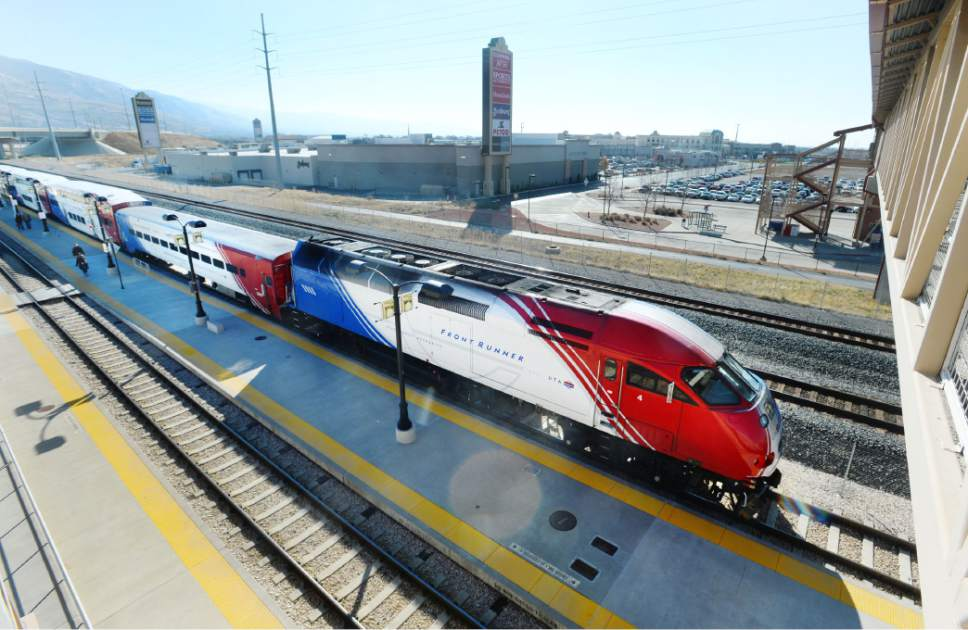 Steve Griffin  |  Tribune file photo Riders disembark a train at the Farmington's Station Park and Ride/FrontRunner Station Monday, November 17, 2014 in Farmington, Utah.