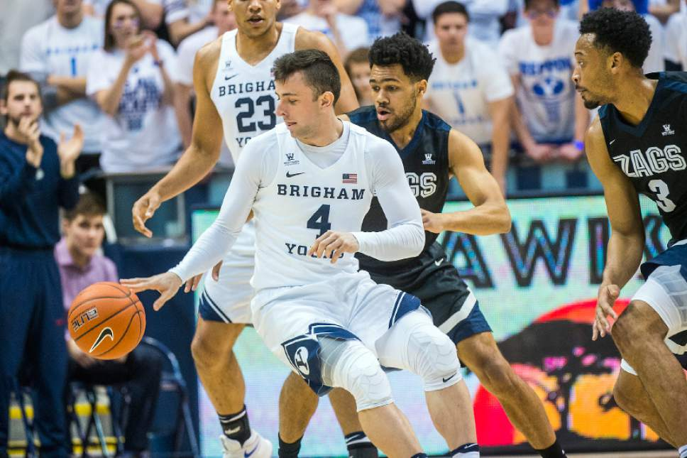 Chris Detrick  |  The Salt Lake Tribune Brigham Young Cougars guard Nick Emery (4) runs around Gonzaga Bulldogs guard Silas Melson (0) during the game at the Marriott Center Thursday February 2, 2017.