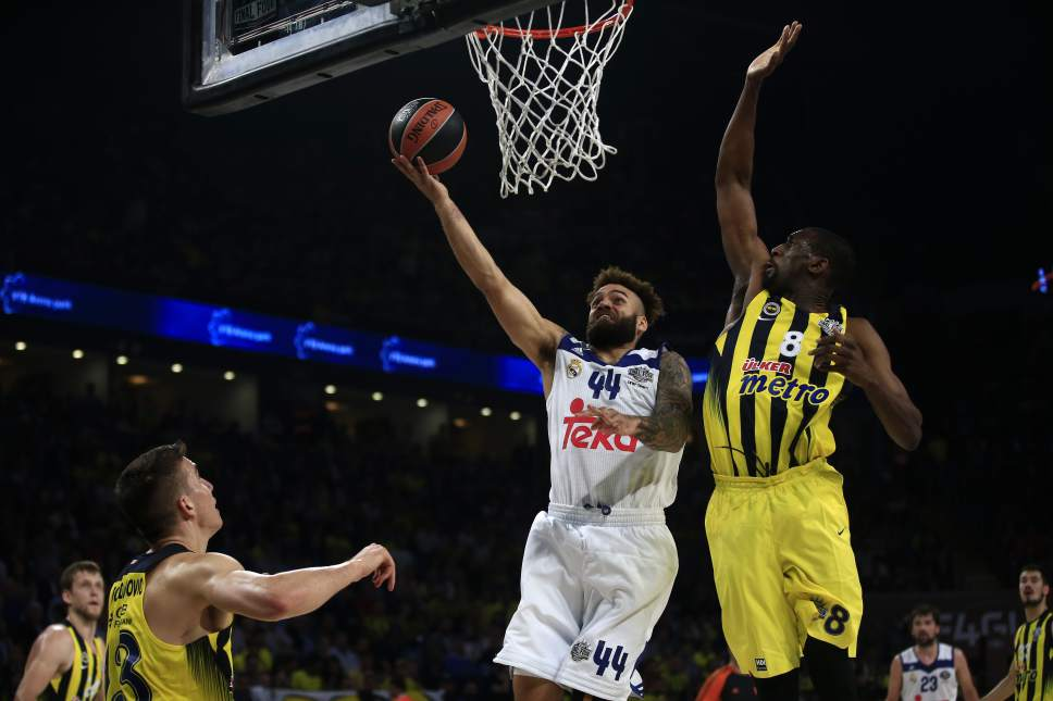 Fenerbahce's Ekpe Udoh, left, tries to stop Real Madrid's Jeffery Taylor during their Final Four Euroleague semifinal basketball match at Sinan Erdem Dome in Istanbul, Friday, May 19, 2017. (AP Photo/Lefteris Pitarakis)