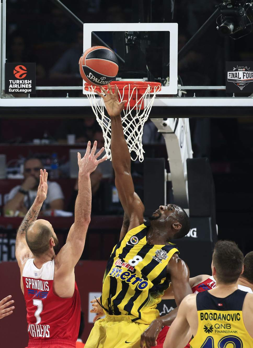 Fenerbahce's Ekpe Udoh, right, blocks a shot by Olympiakos' Vassilis Spanoulis during their Final Four Euroleague final basketball match at Sinan Erdem Dome in Istanbul, Sunday, May 21, 2017. (AP Photo/Lefteris Pitarakis)
