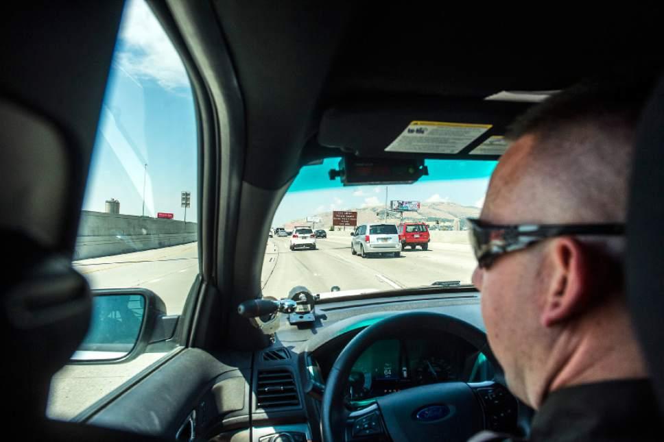 Chris Detrick  |  The Salt Lake Tribune Utah Highway Patrol Trooper Derek Shelby looks for distracted drivers on Interstate 15 Thursday, July 13, 2017.