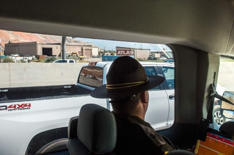 Chris Detrick  |  The Salt Lake Tribune Utah Highway Patrol Lieutenant Corey Nye looks for distracted drivers on Interstate 15 Thursday, July 13, 2017.