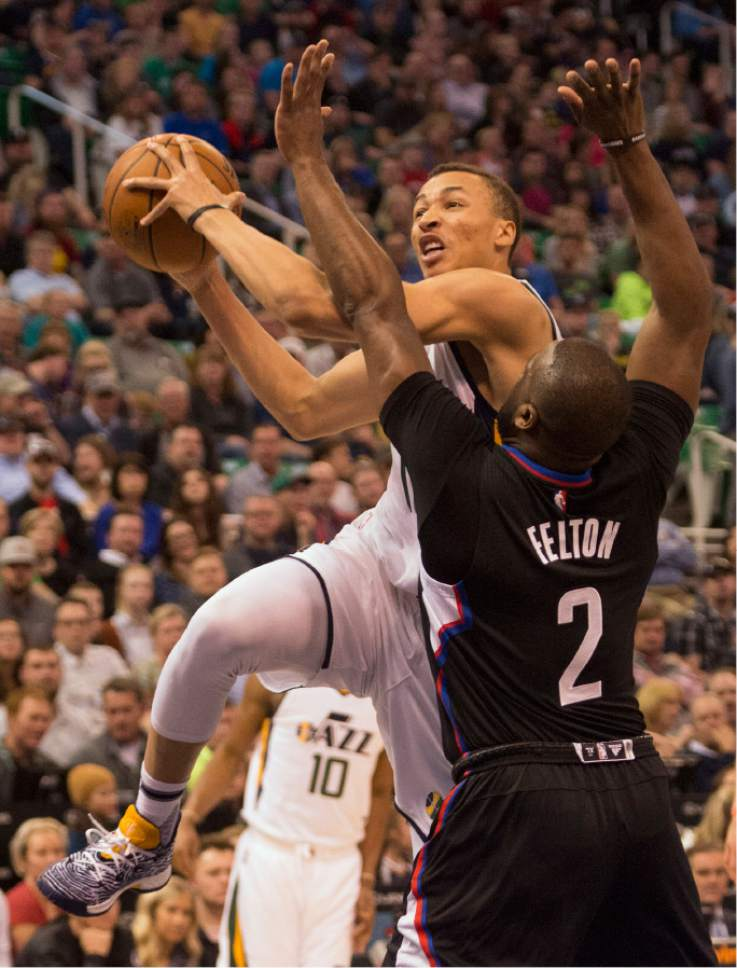 Rick Egan  |  The Salt Lake Tribune  Utah Jazz guard Dante Exum (11) takes the ball to the hoop, as LA Clippers guard Raymond Felton (2) defends, in NBA action Utah Jazz vs. LA Clippers, in Salt Lake City, Monday, March 13, 2017.