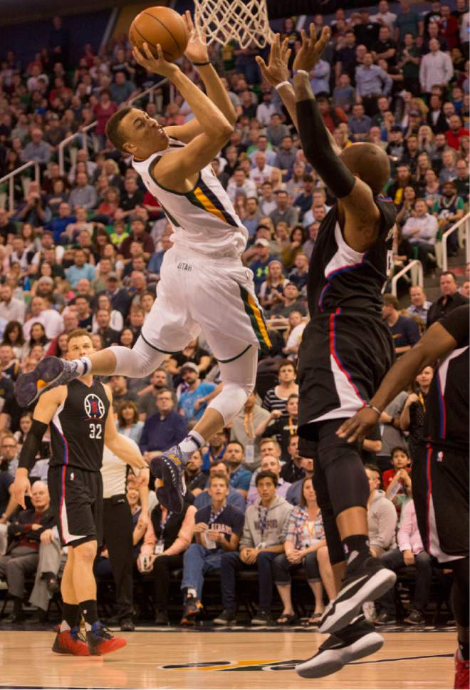 Rick Egan  |  The Salt Lake Tribune  Utah Jazz guard Dante Exum (11) takes a shot as LA Clippers center Marreese Speights (5) defense, in NBA action Utah Jazz vs. LA Clippers, in Salt Lake City, Monday, March 13, 2017.