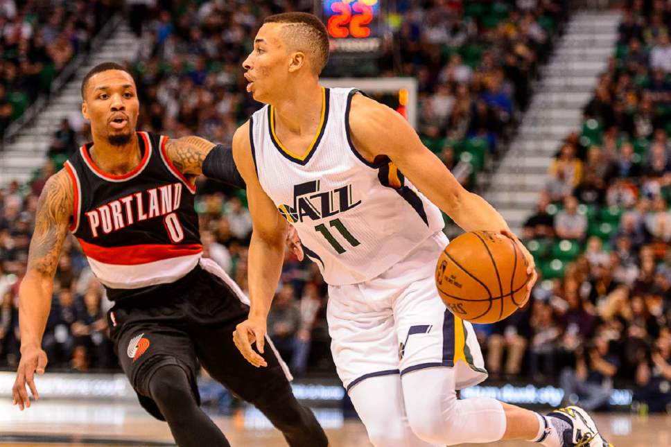 Trent Nelson  |  The Salt Lake Tribune Utah Jazz guard Dante Exum (11) defended by Portland Trail Blazers guard Damian Lillard (0) as the Utah Jazz host the Portland Trailblazers, NBA basketball in Salt Lake City, Wednesday February 15, 2017.