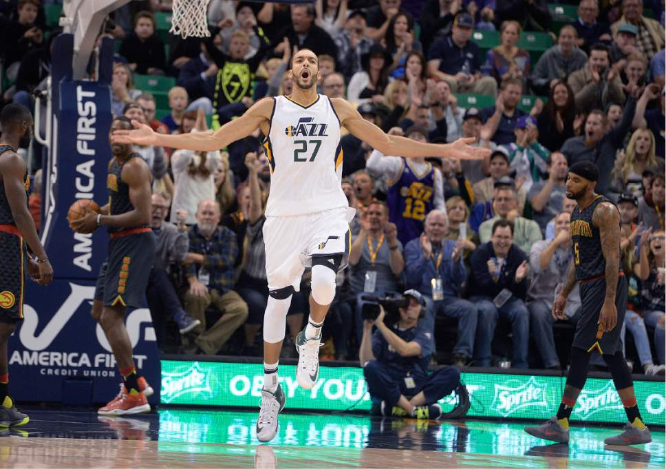 Scott Sommerdorf   |  The Salt Lake Tribune   Utah Jazz center Rudy Gobert, celebrates after a second half dunk by forward Trey Lyles. The Jazz easily beat the Atlanta Hawks 95-68, Friday November 25, 2016.