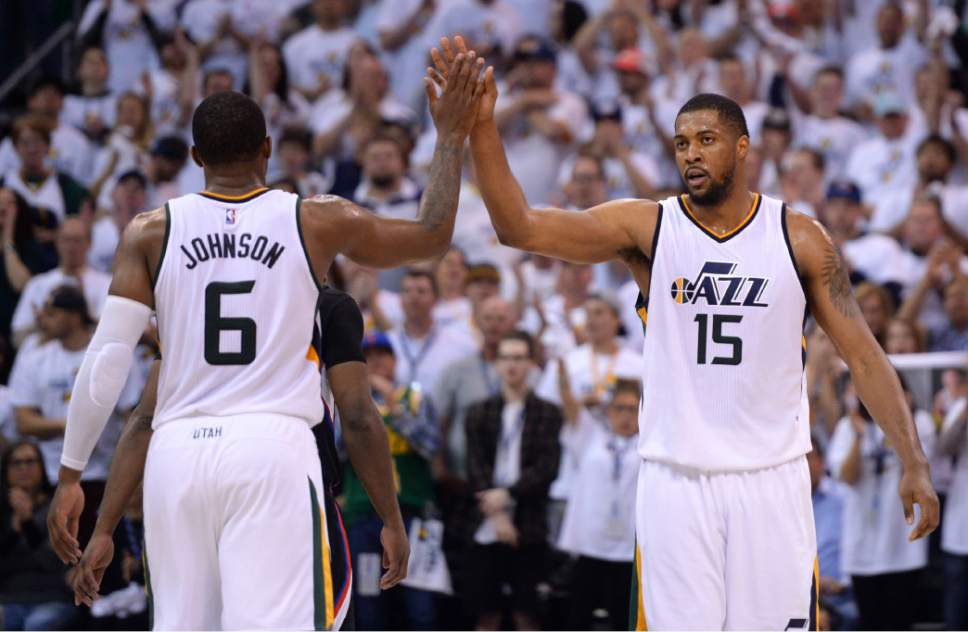 Steve Griffin  |  The Salt Lake Tribune   Utah Jazz forward Joe Johnson (6) and Utah Jazz forward Derrick Favors (15) high-five as the Jazz pull away from the Clippers late in the fourth quarter of their NBA playoff game at Viviint Smart Home arena in Salt Lake City Sunday April 23, 2017.