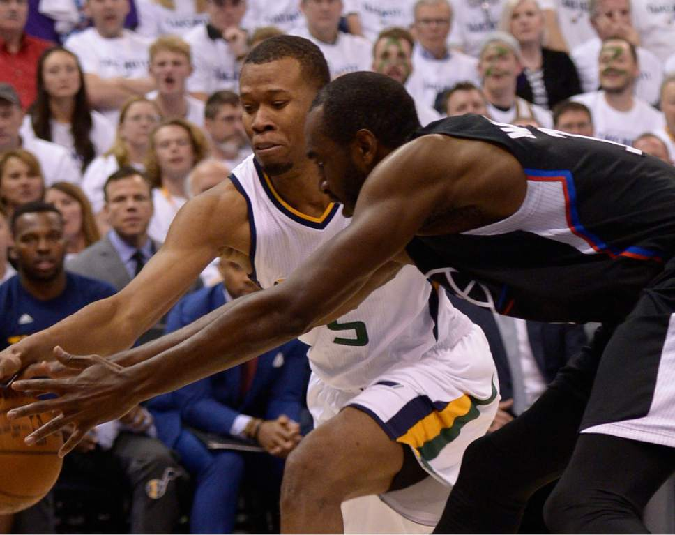 Leah Hogsten  |  The Salt Lake Tribune  Utah Jazz guard Rodney Hood (5) and LA Clippers forward Luc Mbah a Moute (12) fight for a loose ball.  The Utah Jazz lead the Los Angeles Clippers after the third quarter during Game 3 of their first-round Western Conference playoff series at Vivint Smart Home Arena, Friday, April 21, 2017.
