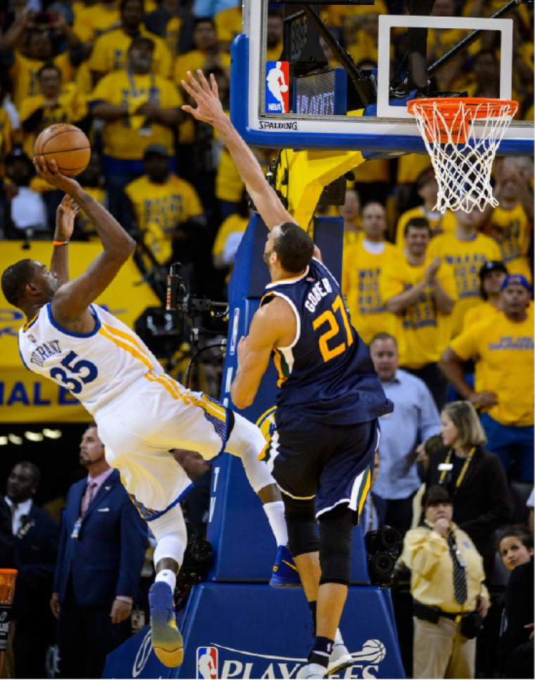 Steve Griffin     The Salt Lake Tribune   Golden State Warriors forward Kevin Durant (35) shoots over Utah Jazz center Rudy Gobert (27) during game 2 of the NBA playoff game between the Utah Jazz and the Golden State Warriors at Oracle Arena in Oakland Thursday May 4, 2017.