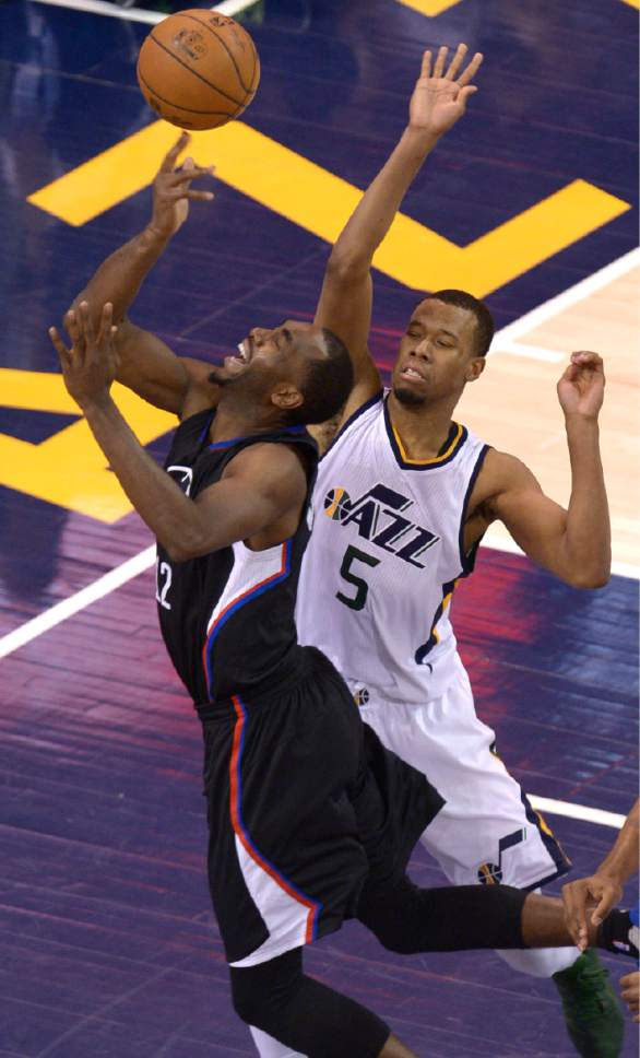 Leah Hogsten     The Salt Lake Tribune  Utah Jazz guard Rodney Hood (5) fouls LA Clippers forward Luc Mbah a Moute (12) in the paint. The Utah Jazz fall to the Los Angeles Clippers 93-98 during Game 6 at Vivint Smart Home Arena, Friday, April 28, 2017 during the NBA's first-round playoff series.