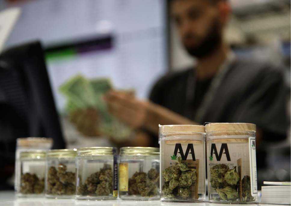 A cashier rings up a marijuana sale at the Essence cannabis dispensary, Saturday, July 1, 2017, in Las Vegas. Nevada dispensaries were legally allowed to sell recreational marijuana starting at 12:01 a.m. Saturday. (AP Photo/John Locher)