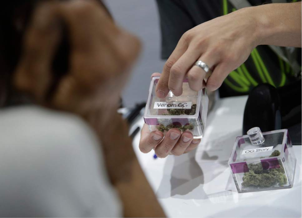 A man shops for marijuana at the Essence cannabis dispensary, Saturday, July 1, 2017, in Las Vegas. Nevada dispensaries were legally allowed to sell recreational marijuana starting at 12:01 a.m. Saturday. (AP Photo/John Locher)