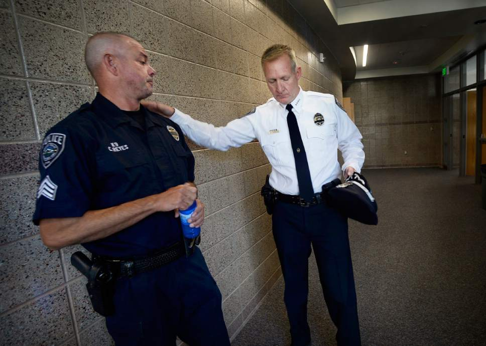 """Scott Sommerdorf      The Salt Lake Tribune   Sgt. Chad Reyes, left, and Sheriff Jim Winder speak in the hallway prior to the memorial service for """"Dingo,"""" a Unified Police Department dog shot and killed in the line of duty July 6 while working with his K-9 handler Sgt. Chad Reyes, Saturday, July 15, 2017."""