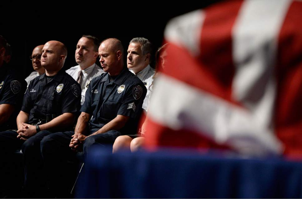 """Scott Sommerdorf      The Salt Lake Tribune  Sgt. Chad Reyes listens during the memorial service on Saturday, July 15, 2017, for his K-9 partner """"Dingo,"""" a Unified Police Department dog shot and killed in the line of duty July 6 while working with Reyes."""