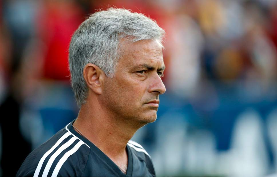 Manchester United coach Jose Mourinho listens to the national anthem before the team's friendly soccer match against the Los Angeles Galaxy on Saturday, July 15, 2017, in Carson, Calif. (AP Photo/Jae C. Hong)