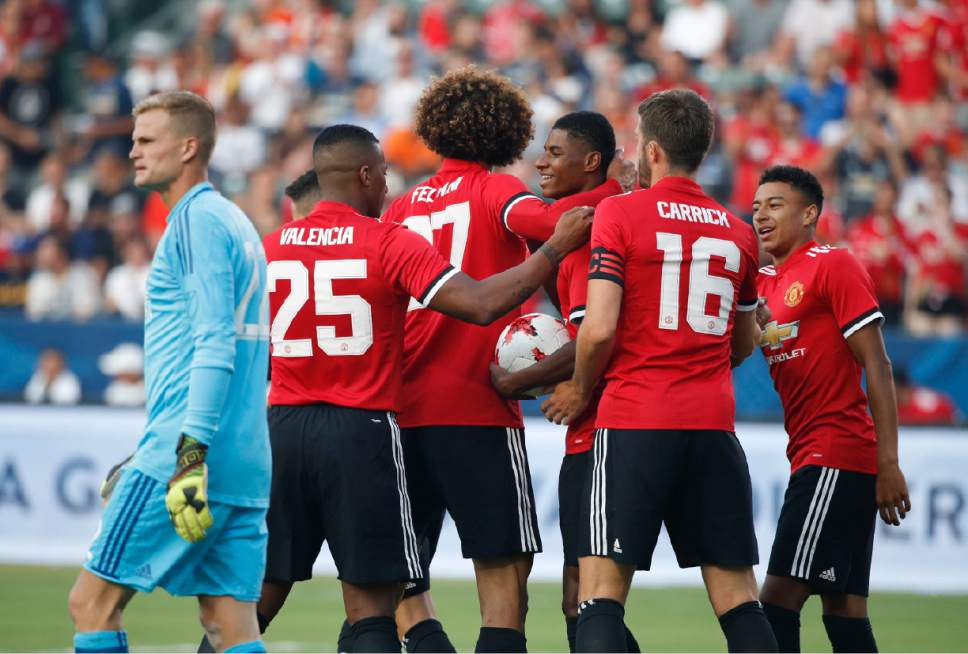 Manchester United players celebrate a goal by Marcus Rashford, third from right, as Los Angeles Galaxy goalkeeper Jon Kempin, left, walks past during the first half of a friendly soccer match Saturday, July 15, 2017, in Carson, Calif. (AP Photo/Jae C. Hong)