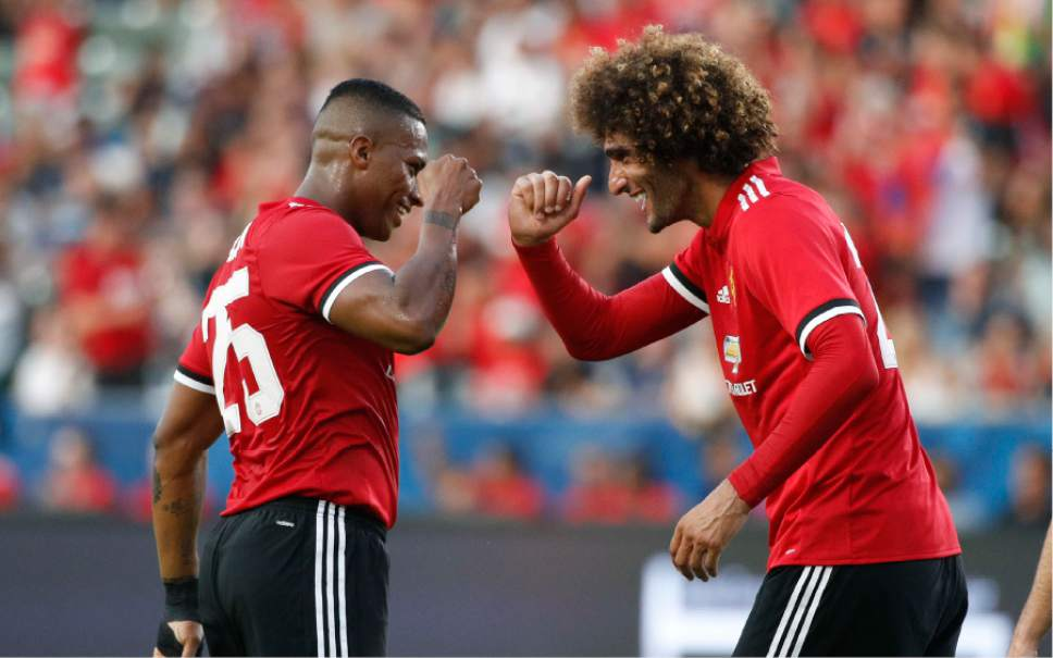 Manchester United's Marouane Fellaini, right, celebrates his goal with Luis Antonio Valencia during the first half of a friendly soccer match against the Los Angeles Galaxy, Saturday, July 15, 2017, in Carson, Calif. (AP Photo/Jae C. Hong)